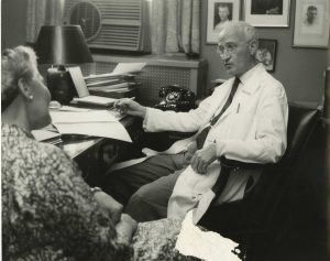 Dr. Dana Atchley interviewing a patient, 1958.  Photo by Elizabeth Wilcox, courtesy Archives & Special Collections, Columbia University Health Sciences Library.