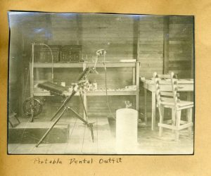 "Dental chair and equipment. This picture accompanied aletter written to Dr. Guy S. Millberry on October 7, 1918. UCSF School of Dentistry scrapbook titled ""Dental College Alumni Serving in the First World War, 1917 – 1919."""